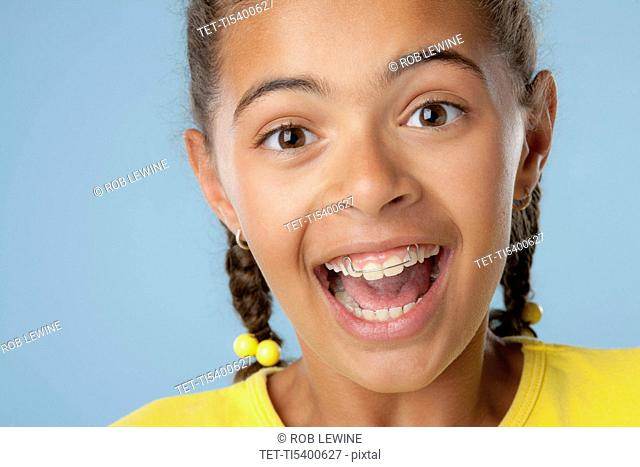 Studio portrait of girl 10-11 laughing