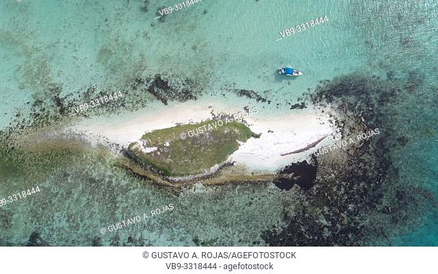 Aerial View Caribbean Island Surrounded by crystal clear waters and beautiful beaches of fine white sand in Los Roques Venezuela