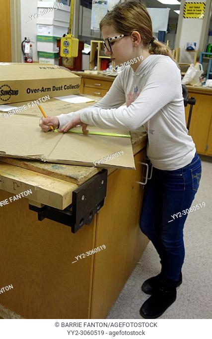 8th Grade Girl Measuring With Ruler in Technology Class, Wellsville, New York, USA