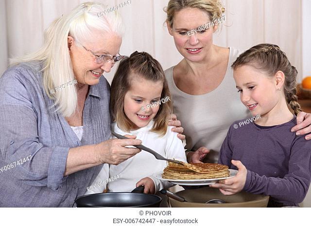 Three generations enjoying crepes