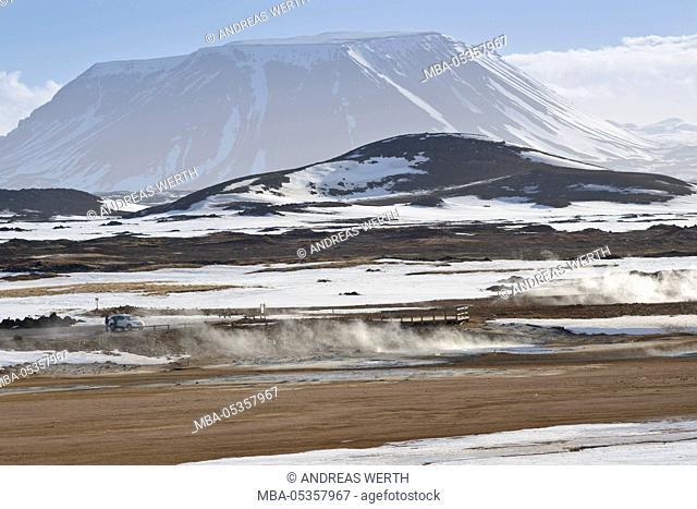 Steam, solfatare, fumarole, mud pots, visitor parking log, visitor platform, mountain Burfell, winter, geothermal area, Iceland, Myvatn area