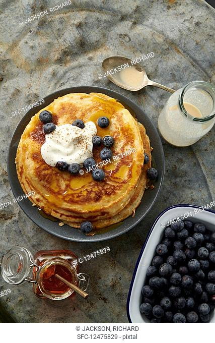 Pancakes with blueberries, maple sYesrup and cream