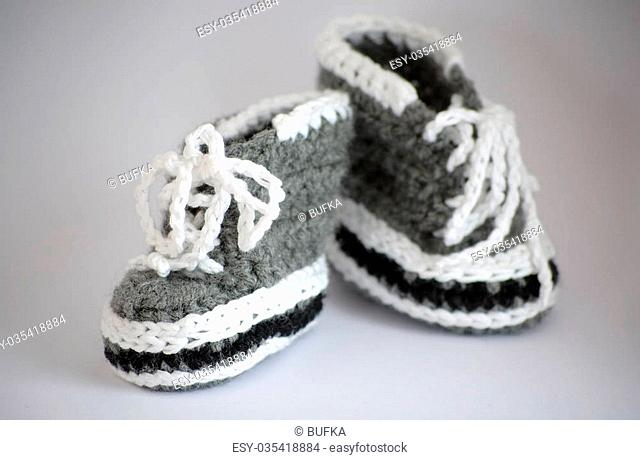 Handmade knitted baby bootees