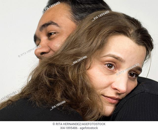 Close-up of mature couple in a hug