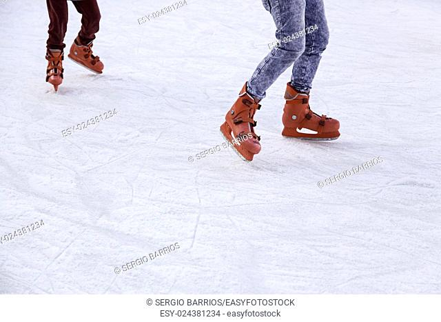 People ice skating, winter sports details