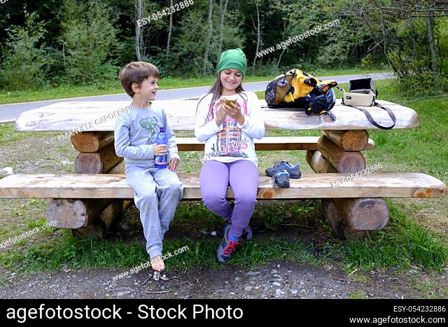 Children play with smartphone at the park