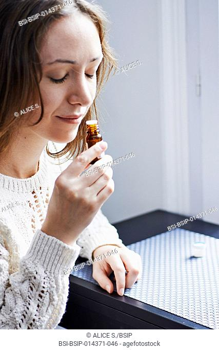 woman smelling essential oil