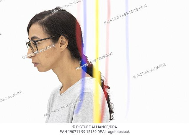 """11 July 2019, Rhineland-Palatinate, Mainz: The artist Latifa Echakhch, who comes from Morocco, stands in her exhibition """"""""Freedom and Tree"""""""" in the Kunsthalle"""