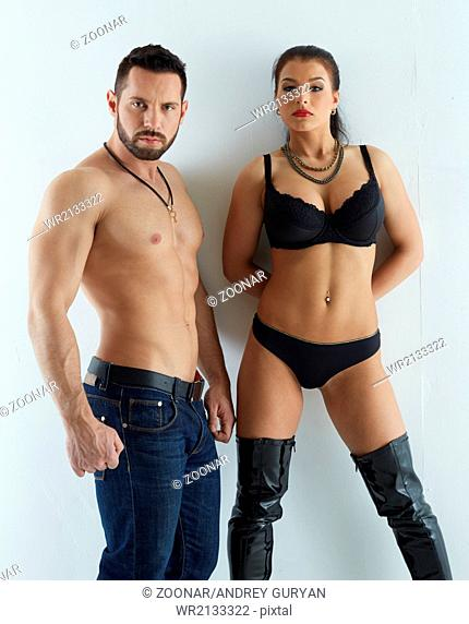 Strength and passion. Handsome man with sexy babe