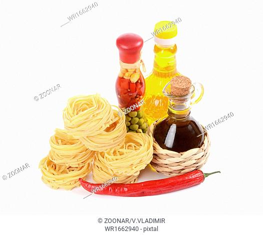 Pasta with an olive oil isolated on white background