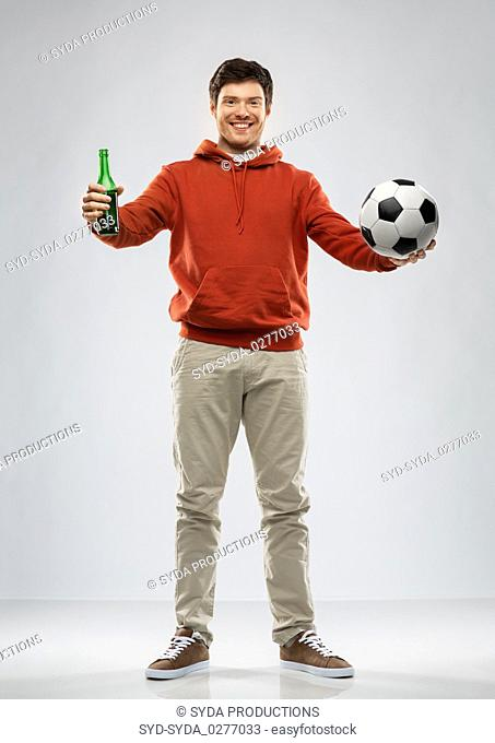 man or football fan with soccer ball and beer