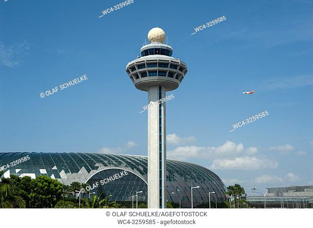 Singapore, Republic of Singapore, Asia - Air traffic control tower and the new Jewel terminal at Singapore's Changi airport