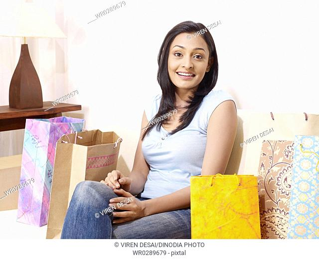 Young lady expressing with hands and colourful shopping bags MR702U