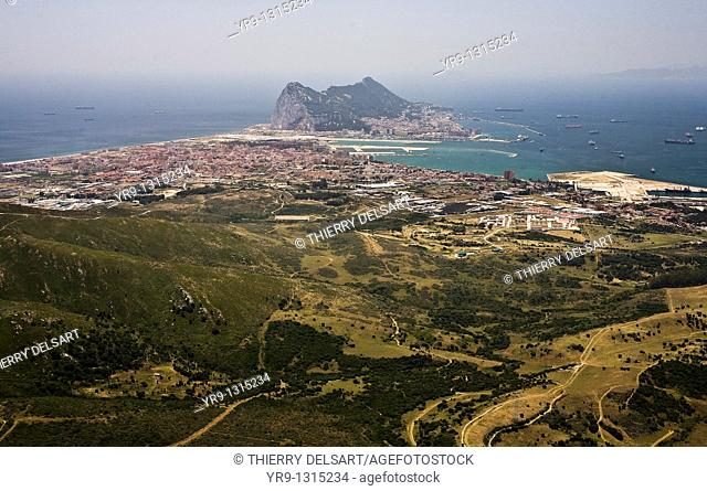 'The rock' Gibraltar, aerial view, La Línea de la Concepción in the front, Africa's mountains in the back. The bay is always full of ancored ships waiting
