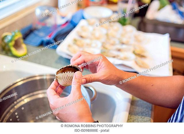 Woman preparing scallop dinner