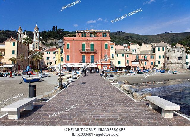 Pier, fishing boats on the beach, behind the church of San Matteo, Laigueglia, port town on the Ligurian coast, Riviera di Ponente, Liguria, Italy, Europe