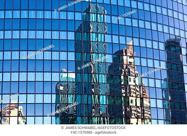 Reflections of buildings in glass windows of Phoenix Mutual Life Insurance Building in downtown Hartford Connecticut