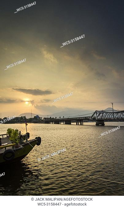 landmark old bridge and river at sunset in kampot cambodia