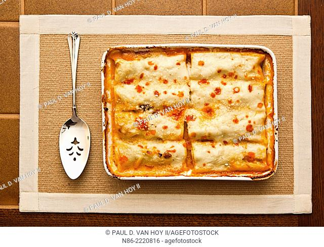 chicken cannelloni in ceramic serving dish