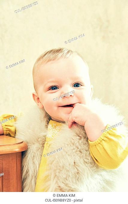 Portrait of baby girl sucking her thumb