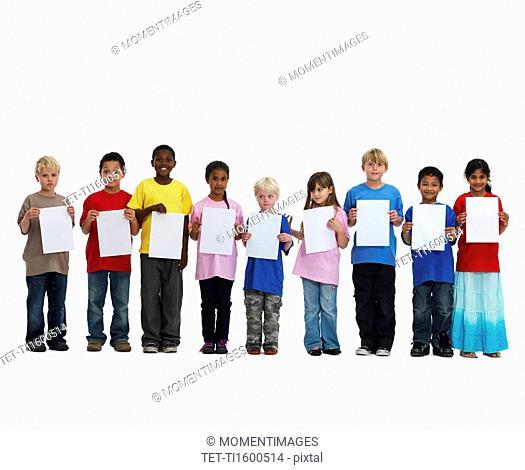 Children holding paper