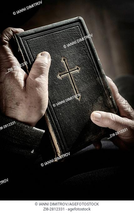 Woman holds old bible