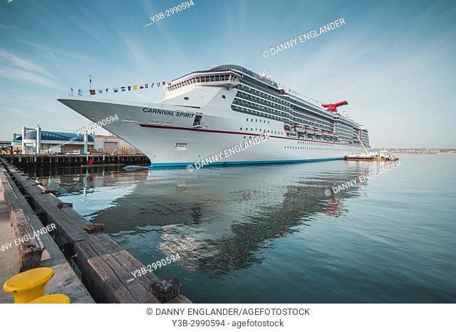 A modern cruise ship docked in port on San Diego Bay, California
