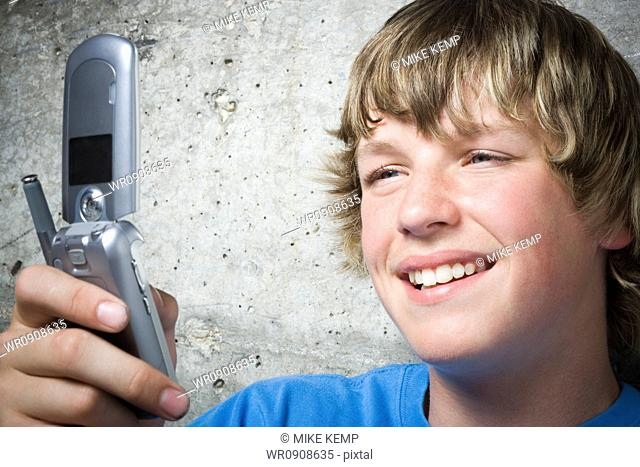 Close-up of a teenage boy using a mobile phone