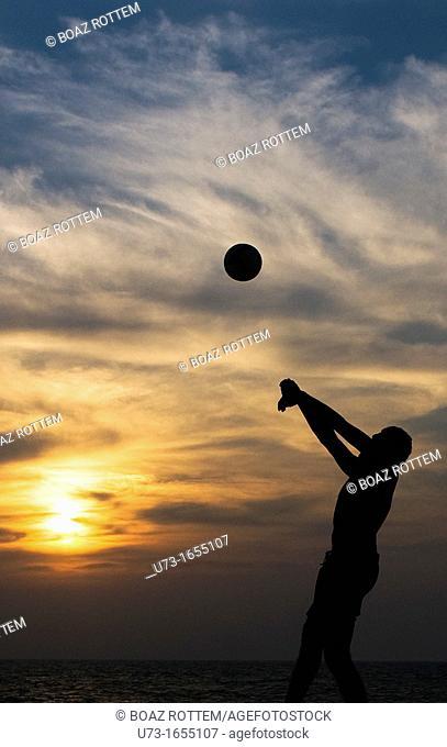 Beach volleyball during sunset on Negombo beach, Sri Lanka