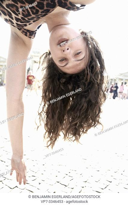 young woman upside down in city Berlin, Germany
