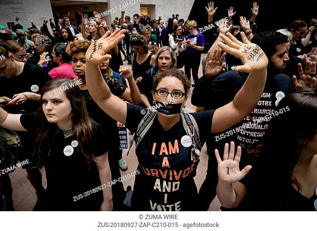 September 27, 2018 - Washington, District of Columbia, United States - Protesters assembled in the foyer of the Hart Senate Office Building during the hearing...