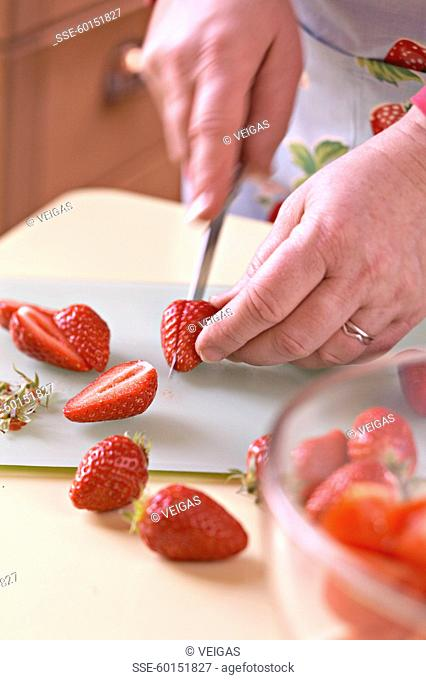 Cutting the strawberries in half