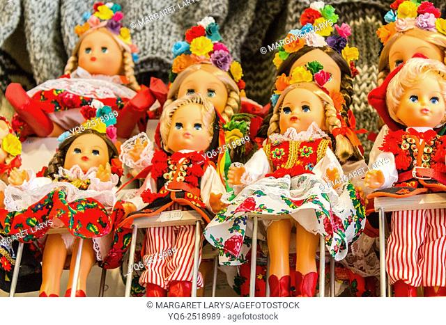 Dolls for sale wearing national, folk, symbolic and traditional costumes of Krakow, Poland, Europe