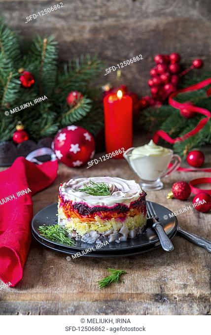 Russian Shuba salad with herring, potato, carrots, beetroot and sour cream