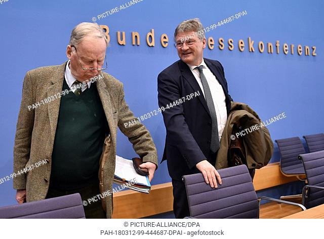 12 March 2018, Germany, Berlin: Alexander Gauland (L) and Joerg Meuthen, chairmen of Alternative for Germany (AfD), give a press conference about the signing of...