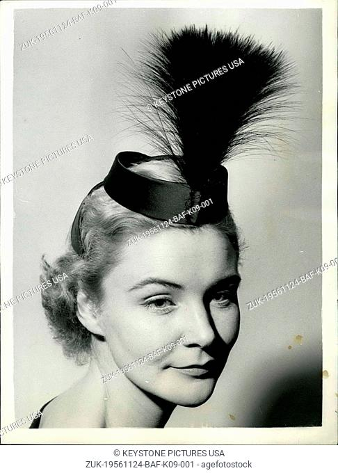 Nov. 24, 1956 - For the Spring - from the Otto Lucas Collection: Photo Shows Called 'Maxim' - this black satin cocktail coiffe, with an osprey feather