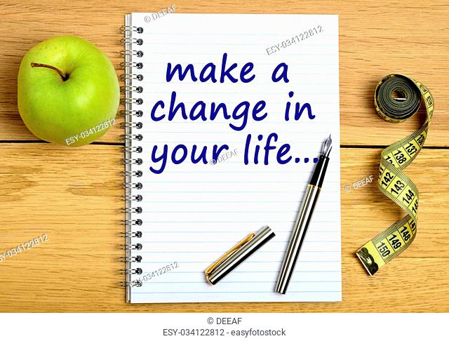 Words Make a change in your life on notebook