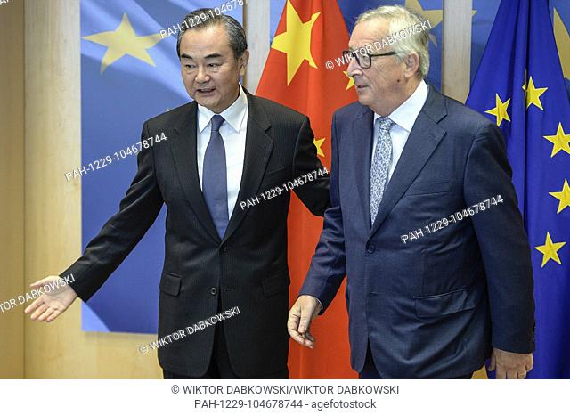 Jean-Claude Juncker , the president of the European Commission (L) welcomes China's Foreign Minister Wang Yi at European Commission headquarters in Brussels