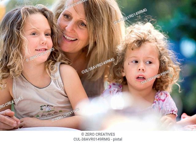 Woman with grandchildren outdoors
