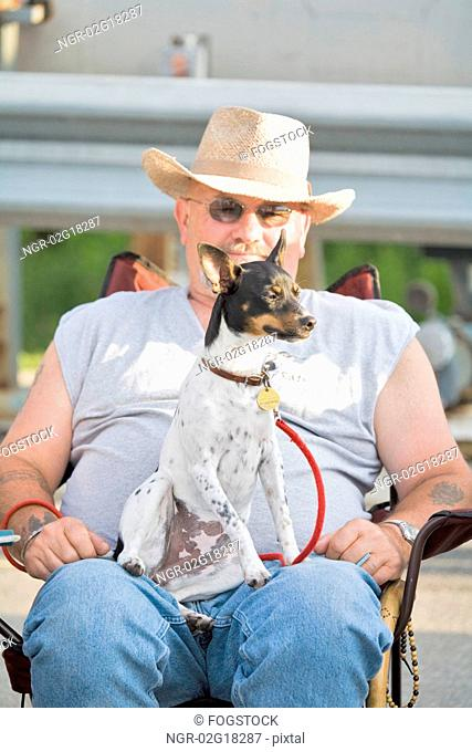 Man with Rat Terrier Sitting on Lap