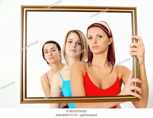 women in picture frames