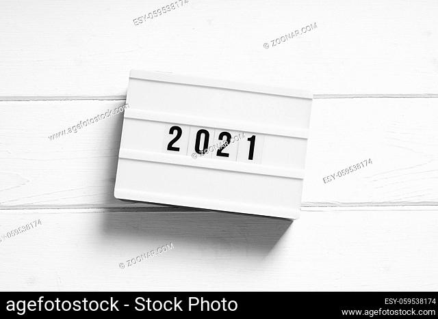 year 2021 on light box sign - minimalist preview or review concept
