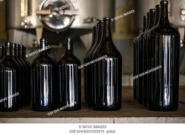 Wine Bottles of Various Sizes in Winery