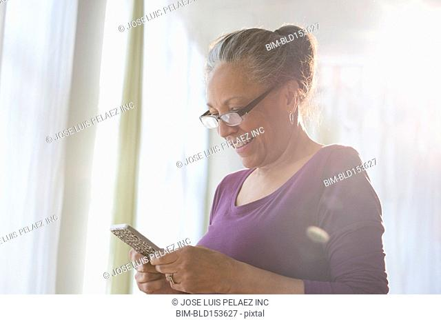 Older Hispanic woman using digital tablet