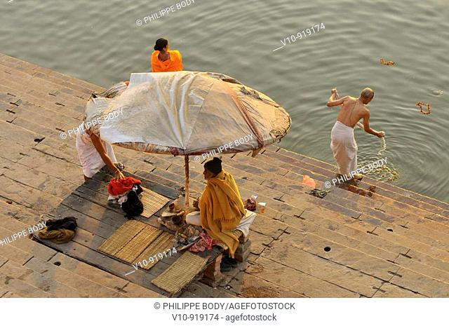 India, Uttar pradesh, Varanasi, Benares, hindu people bathing and praying in Ganga river