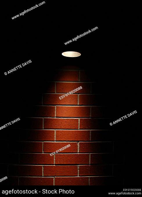 Spotlight on a red brick wall