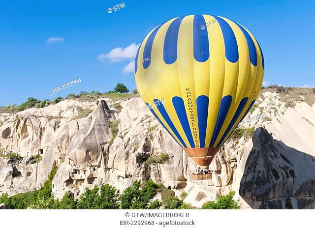 Hot air balloon over Goreme valley, Cappadocia, Turkey, Asia