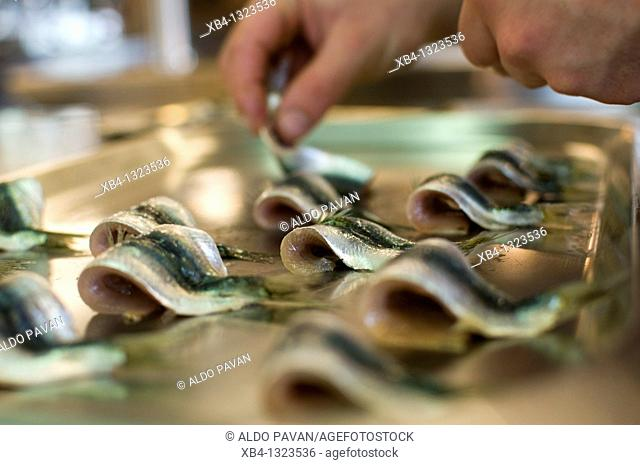 Preparing food with pilchards, Estate of Scarpa Volo now Venissa hotel and restaurant, Mazzorbo island, Venice, Italy