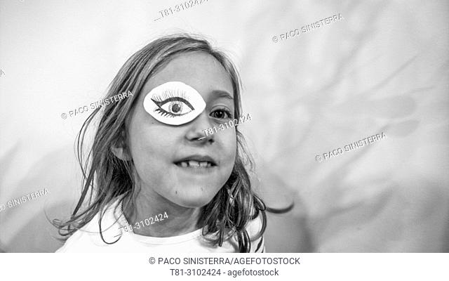 Girl with eye patch. Valencia, Spain