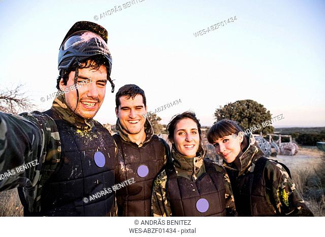 Selfie photo of smiling paintball players